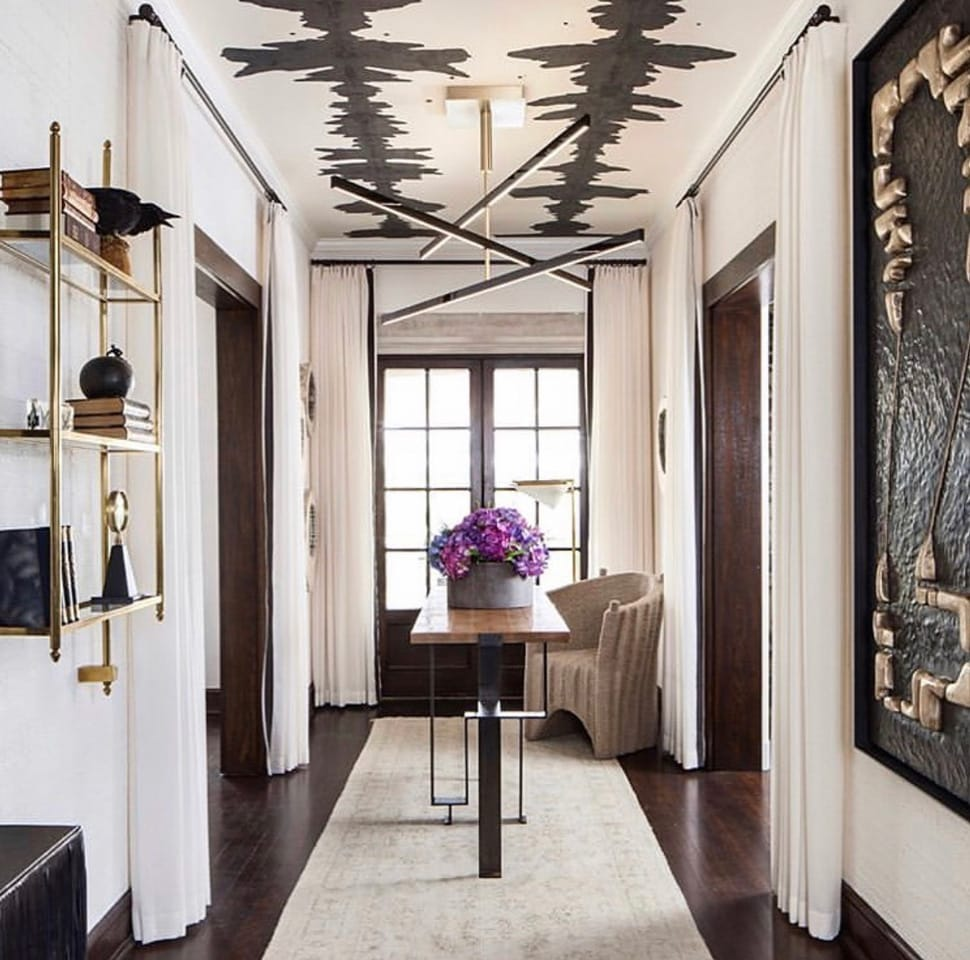 Image of hallway with wallpapered ceiling referenced in the Atlas Concorde USA blog from Porter Teleo