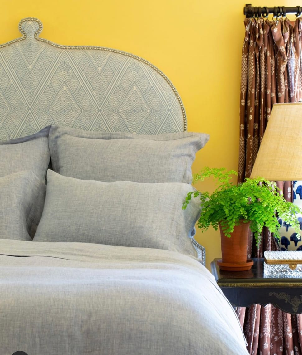 Image of yellow wall in bedroom referenced in Atlas Concorde USA blog from John Robshaw