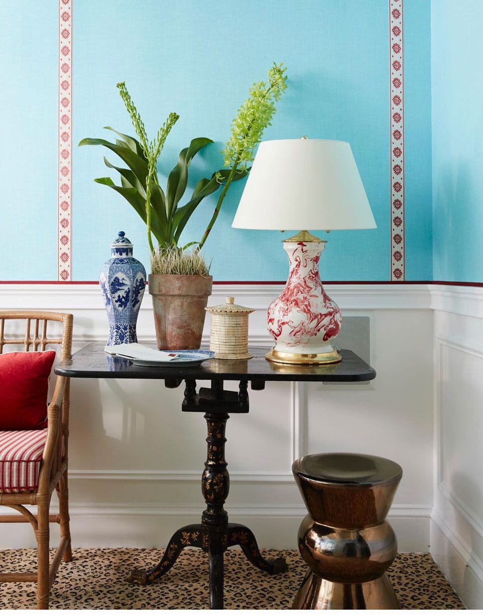 Blue wall entry with red lamp featured in the Atlas Concorde USA blog by Mark D. Sikes Interiors