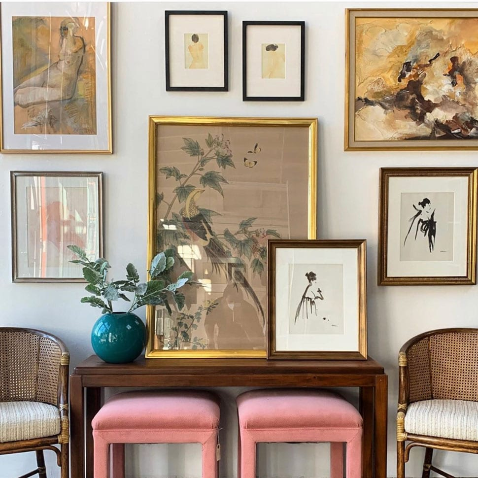 Gallery wall with pink benches referenced in the Atlas Concorde USA blog from Vintageluxe