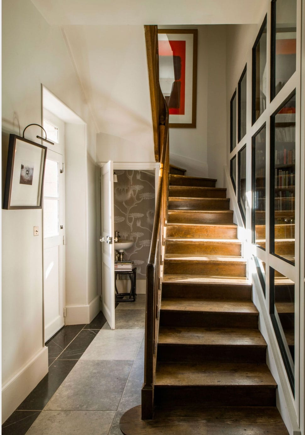 Staircase with window wall referenced in the Atlas Concorde USA blog from Architectural Digest