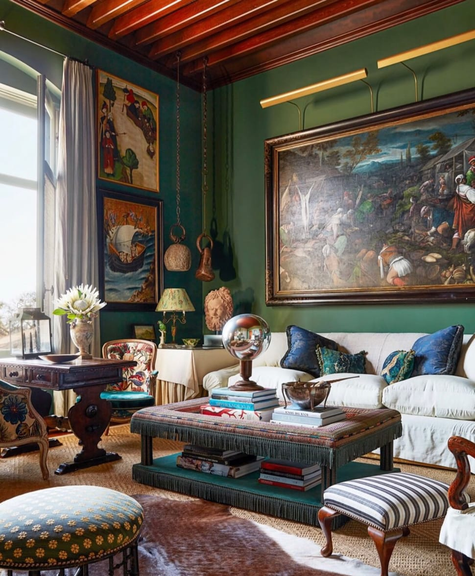 Image of living room with green details referenced in the Atlas Concorde USA blog from Studio Shamshiri