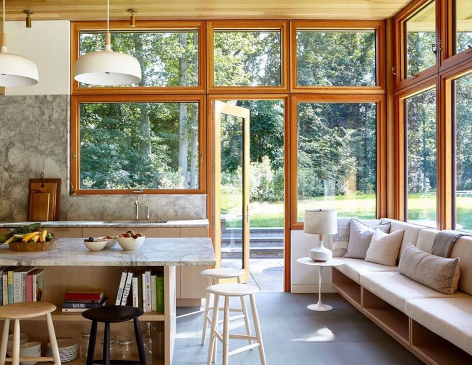 Kitchen with windows image referenced in the Atlas Concorde USA blog from Architectural Digest