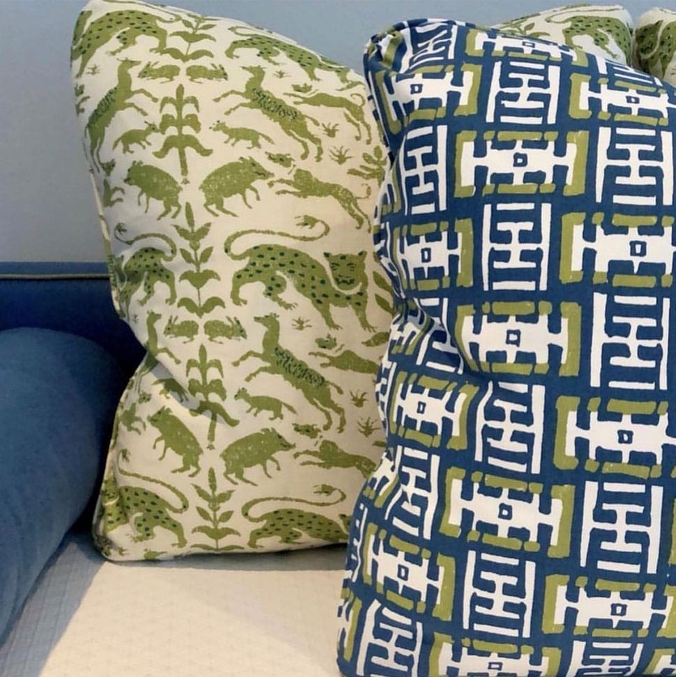Image of colorful throw pillows referenced in the Atlas Concorde USA blog from JAMES home décor
