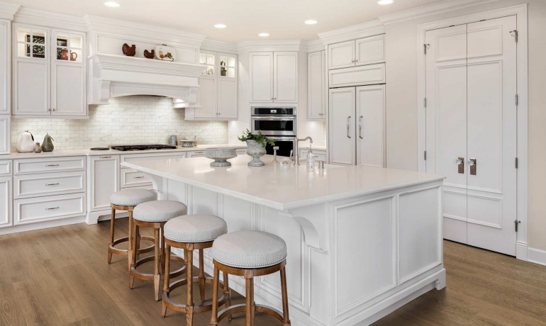 Bright kitchen with wood and marble-looking tiles from Atlas Concorde USA