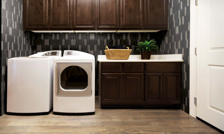 Rustic laundry room with wood and metal-looking tiles from Atlas Concorde USA