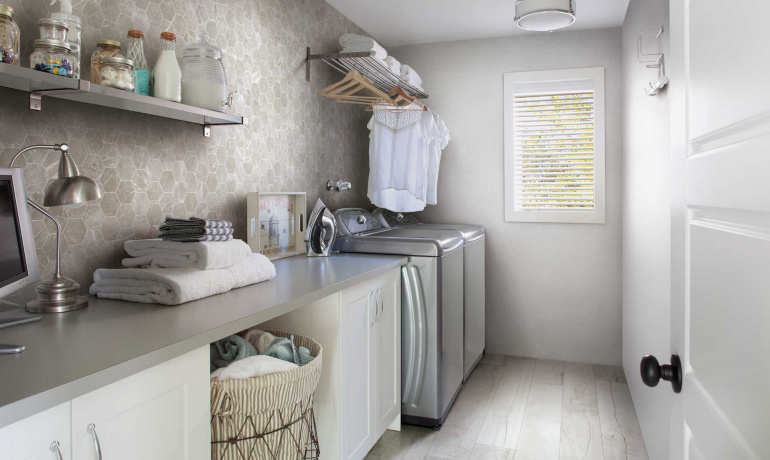 Bright and airy mudroom featuring marble and wood-looking porcealin tiles by Atlas Concorde USA