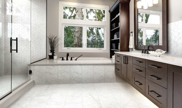 Residential bathroom featuring marble inspired porcelain tiles from Atlas Concorde USA