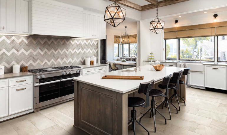 Grand kitchen with rustic vibe features a stone and concrete-looking porcelain tiles from Altas Concorde USA