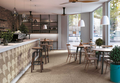 Beautiful porcelain tile coffee shop with a cork look from the Atlas Concorde USA Korc Collection