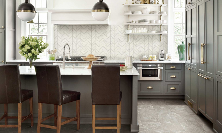 Marble inspired porcelain tiles by Atlas Concorde USA featured in a Transitional kitchen