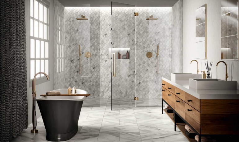 Beautiful master bathroom featuring Trilogy marble-inspired porcelain tile from Atlas Concorde USA