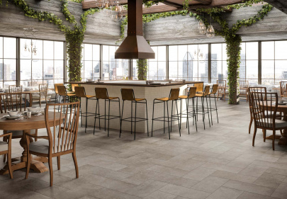 Beautiful porcelain tile restaurant with a stone look from the Atlas Concorde USA Rooted Collection